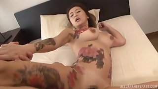 Two scalding guys use and abuse a tattooed Japanese MILF